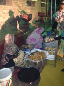 Real tea ladies--traditional Sudanese coffee, minted tea and donuts